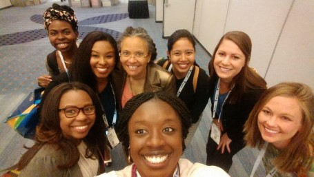 Lauren Biagoli (back left) with APHA President Dr. Camara Jones (back center) and other MCH Student Fellows, past and present